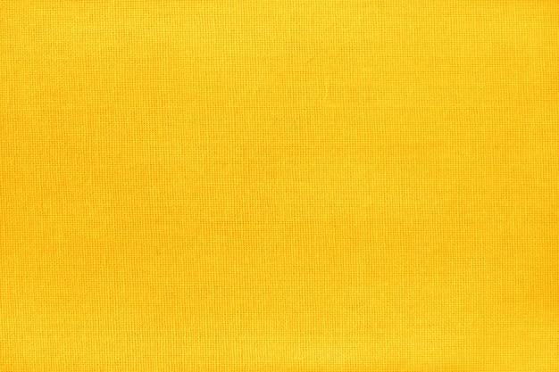 Żółta złota bawełniana tkanina tekstura z bezszwowym wzorem.