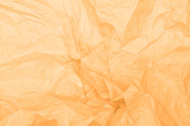 Żółta, złota zmięta tekstura papieru, beżowe tło, tapeta