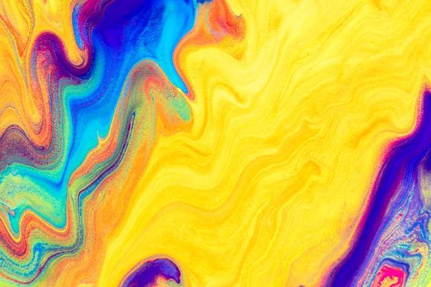 Żółte płynne marmurowe tło ręcznie kolorowe płynne tekstury sztuka eksperymentalna