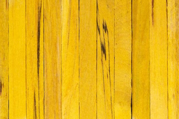 Żółtego koloru tekstury drewniany tło