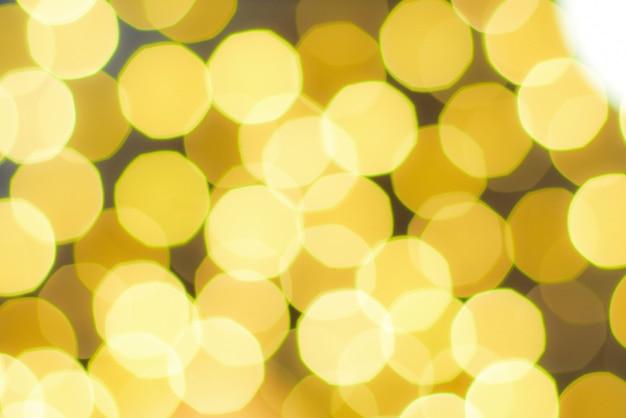 Żółtego światła bokeh świętowanie, bożonarodzeniowe światła bokeh