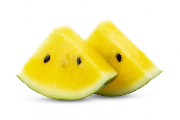 Żółty arbuz na bielu stole.