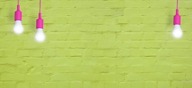 Żółty ceglany mur z żarówkami. kreatywna kopia miejsca na tekst lub obraz. format banera