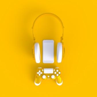 Żółty joystick z żółtymi słuchawkami i smartfonem