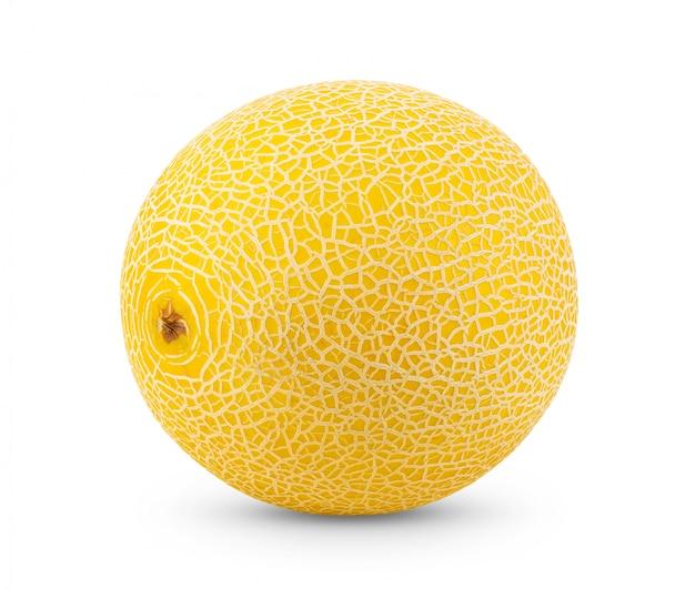Żółty kantalupa melon na bielu stole.