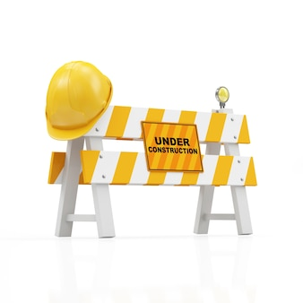 Żółty kask ochronny na barierze drogowej