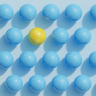 Żółty kolor piłki nożnej wyróżniający się na niebiesko kolor piłki nożnej na niebiesko