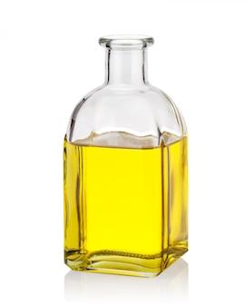 Żółty olej w szklanej butelce