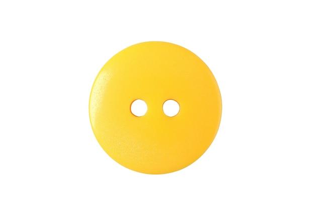 Żółty przycisk na białym tle z bliska