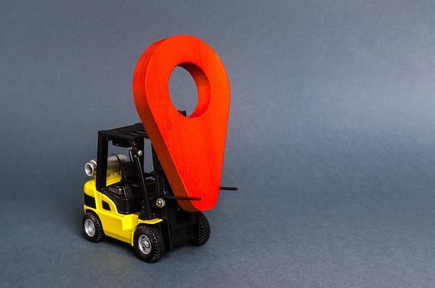 Żółty wózek widłowy z czerwonym wskaźnikiem lokalizacji usługi transportowe i zarządzanie logistyką