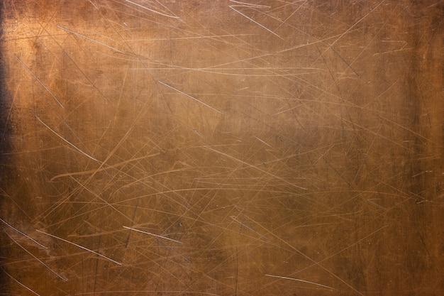 Zużyta blacha miedziana, zbliżenie tekstury metalu, tło