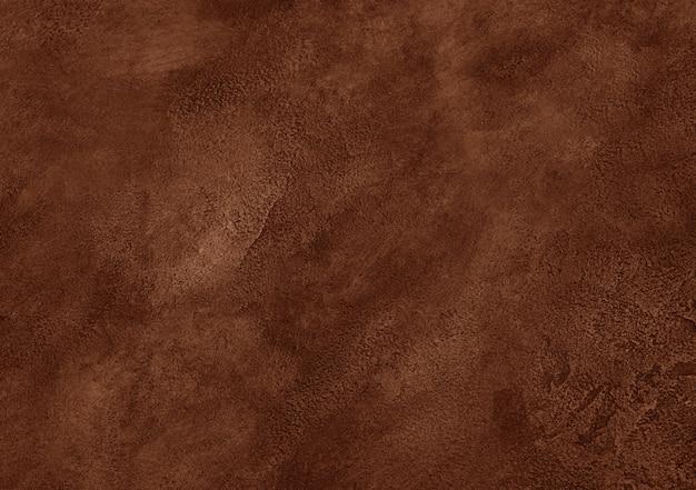 Zużyty brązowy marmur lub pęknięty betonowy tło