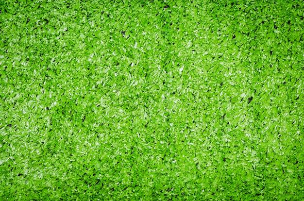 Zwinięta zielona sztuczna murawa