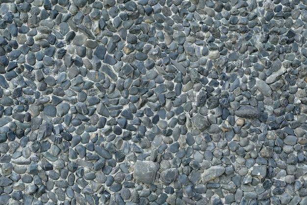 Żwir kamień tekstury tła ściany małe kamienie, które zostały zerodowane przez wodę, są używane do dekoracji ściany.