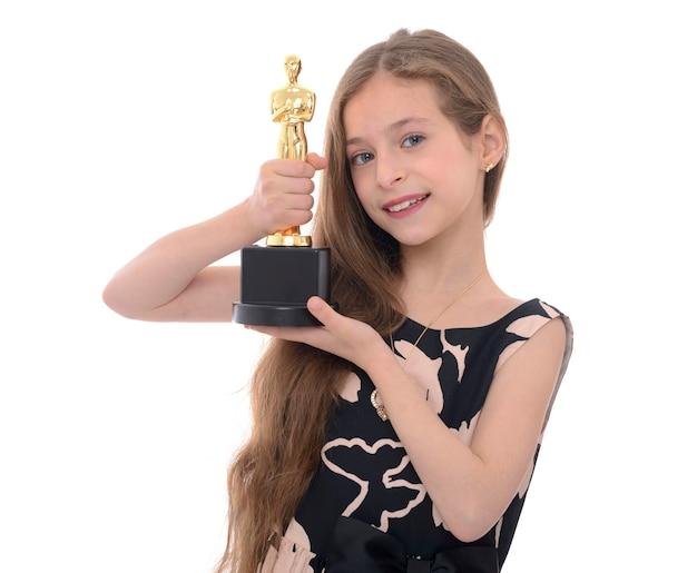 Zwycięzca girl holding trophy