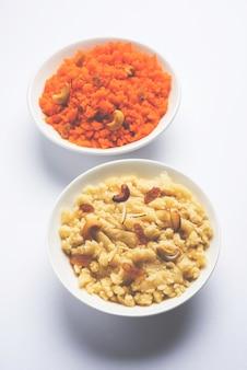 Zwykła lub szafranowa semolina lub soji halwa znana również jako sweet rava sheera or shira - indyjskie słodycze na festiwal przyozdobione suszonymi owocami. podawane w talerzu lub misce, selektywne focus
