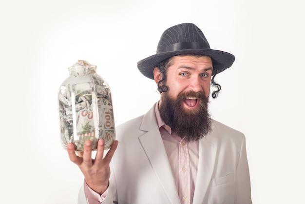 Żyd brodaty żydowski mężczyzna z pieniędzmi portret brodaty ortodoksyjny żydowski mężczyzna purim biznes