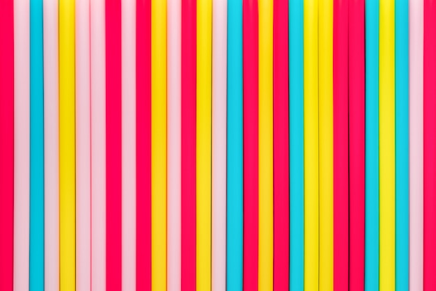 Żywe kolorowe słoma układali w vertical dla tła