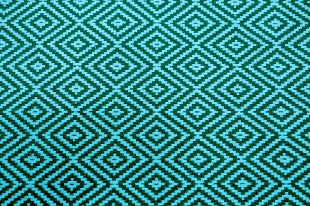 Żywy i głęboki turkusowy niebieski kolor etniczne bezszwowe wzór tkaniny na tle