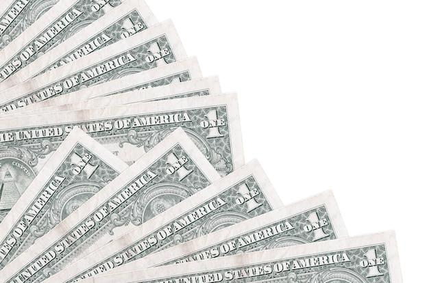 1 billetes de dólar estadounidense se encuentra aislado sobre fondo blanco con espacio de copia apilados en el ventilador de cerca