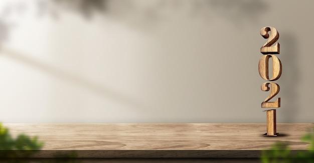 2021 feliz año nuevo madera sobre fondo de mesa de madera con luz solar y planta