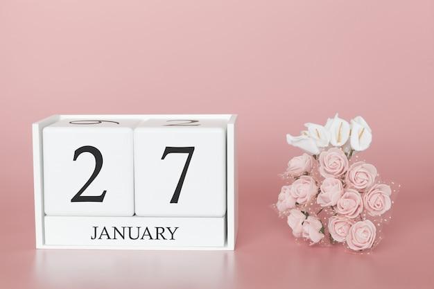 27 de enero. día 27 del mes. haga calendarios el cubo en fondo rosado moderno, el concepto de negocio y un acontecimiento importante.