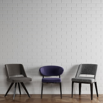3 sillas diferentes en estilo moderno de pie delante de la pared de ladrillo blanco con copyspace