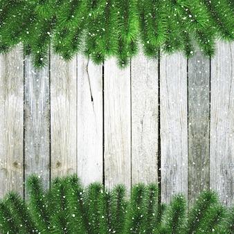 3d ramas de los árboles de navidad con nieve en una textura de madera