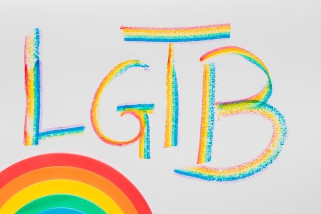 Abreviatura lgbt y colorido arco iris