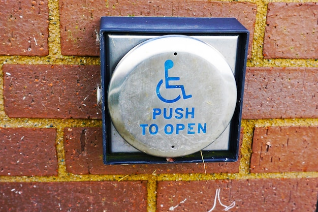 Abridor de puerta de botón de handicap