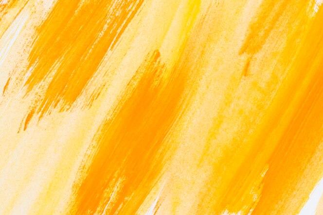 Abstracto pintado fondo acuarela amarillo en textura de papel