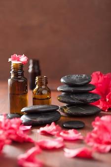 Aceite esencial azalea flores piedras de masaje negro