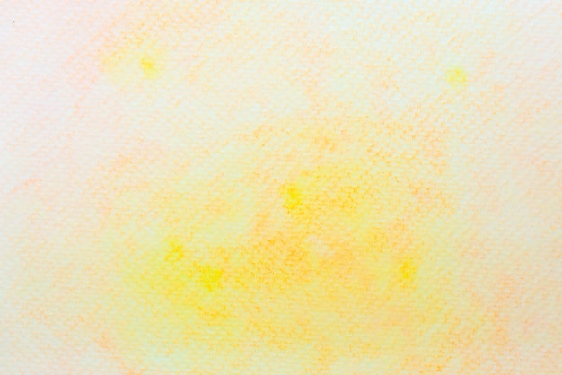 Acuarela abstracta amarilla y naranja sobre papel