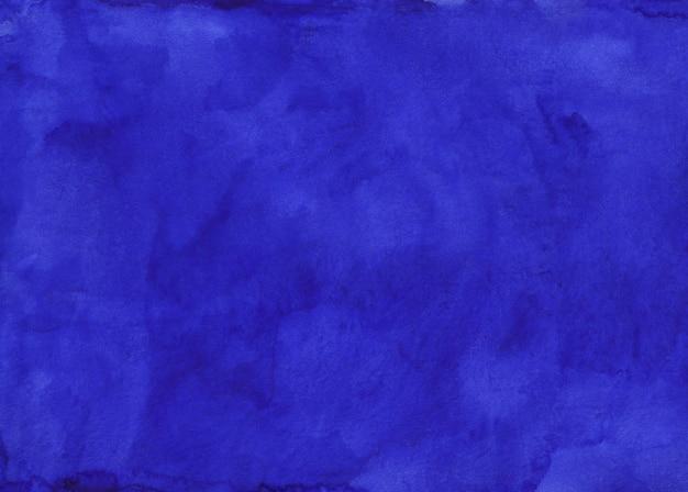 Acuarela azul índigo profundo textura de fondo pintado a mano. manchas de acuarela sobre papel.