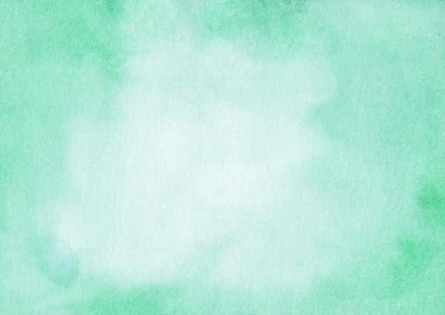 Acuarela color menta y superficie blanca.