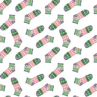 Acuarela de patrones sin fisuras con calcetines de adorno de navidad.