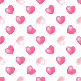 Acuarela de patrones sin fisuras con corazones rosados, rojos sobre fondo blanco