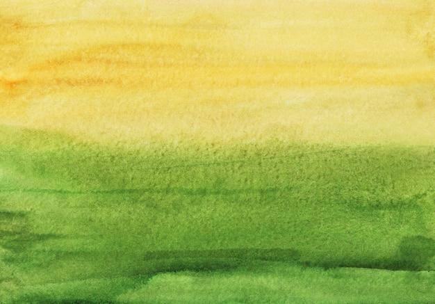 Acuarela pintura de fondo verde y amarillo. textura de color de agua abstracta.