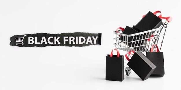 Acuerdo de venta de viernes negro con carrito de compras.