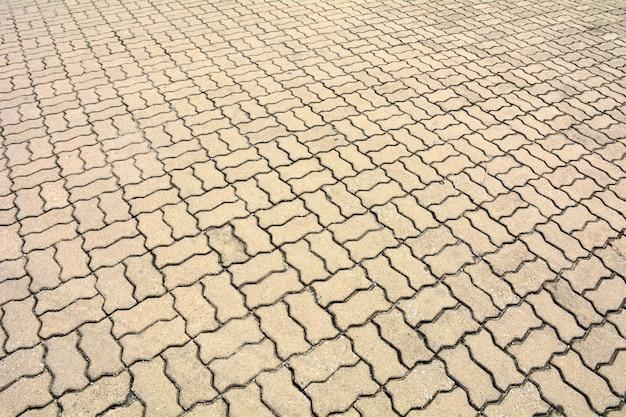 Adoquines estampados, fondo de piso de ladrillo de cemento viejo