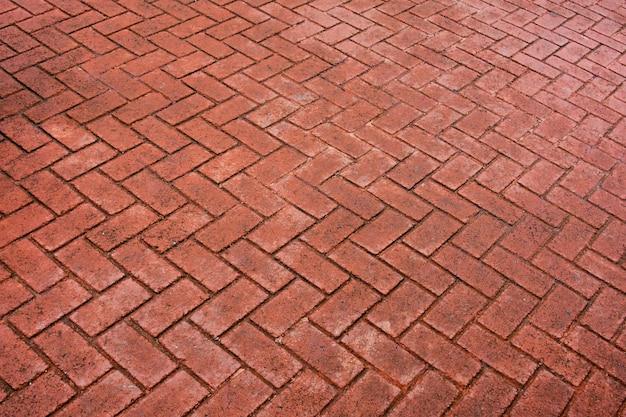 Adoquines estampados, viejo fondo de piso de ladrillo de cemento rojo