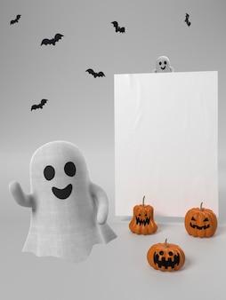 Adorno de halloween con fantasmas y calabazas.