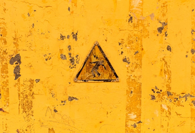 Advertencia eléctrica textura o fondo amarillo