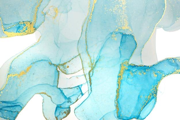Alcohol tinta azul y oro abstracto