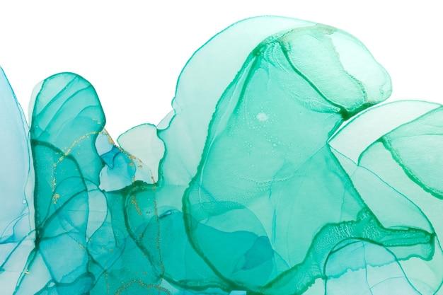 Alcohol tinta azul y verde abstracto