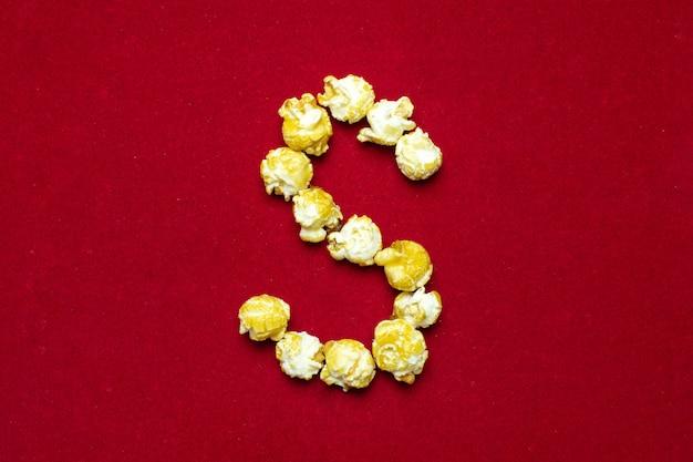 Alfabeto inglés del cine palomitas de maíz, fondo, letra s