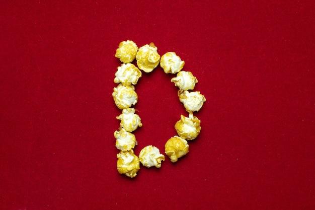 Alfabeto inglés de fondo de palomitas de cine, letra d