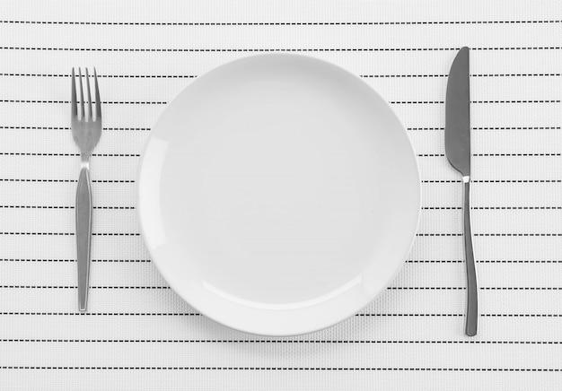 Alfombra de placa con horquilla y cuchillo