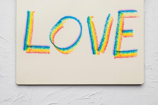 Amor palabra dibujada líneas brillantes en colores lgbt