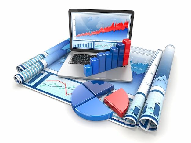 Analizar negocios. computadora portátil, gráfico y diagrama.